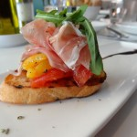 PROSCIUTTO DI PARMA Vine ripe tomatoes, peppers, oregano & prosciutto di Parma PAIRED WITH: ZARDETTO PROSECCO BRUT CONEGLIANO, VENETO Straw-lemon with a fine perlage, fragrant aromas of peach, citrus and tropical fruits.