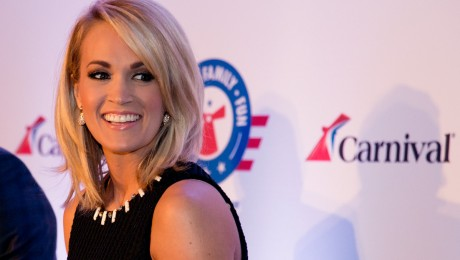 Carrie Underwood, right, reacts to a comment at a news conference Thursday, Jan. 28, 2016, in Jacksonville, Fla. At left is Brig. Gen. John Pray, president and CEO of Operation Homefront. Underwood, Operation Homefront and Carnival Cruise Line announced a partnership to begin a new initiative to support U.S. military families. The effort between the three entities is to raise funds through a series of projects during Underwood's concert tour and aboard Carnival's ships as well as the company's website. FOR EDITORIAL USE ONLY (Andy Newman/Carnival Cruise Line/HO)